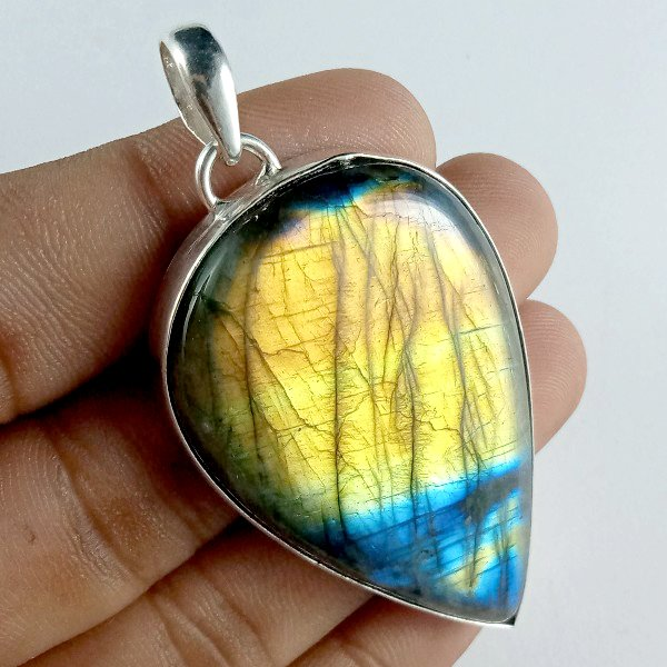 125CTS Labradorite Multi Fire Silver Overly Pear Pendant Size 58x34mm.