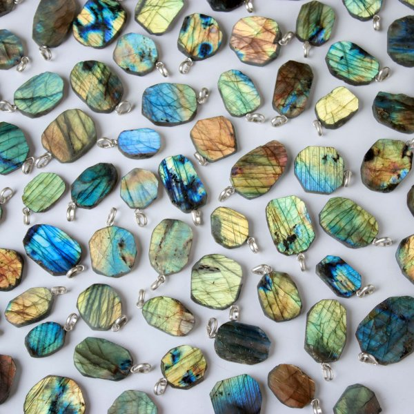 1704Cts. 77Pcs Labradorite Slice pendant free Shape 35X23 To 17X11 mm.