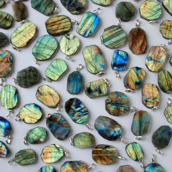 1703Cts. 77Pcs Labradorite Slice pendant free Shape 32X23 To 20X12 mm.